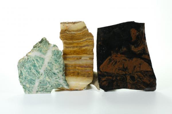 Mariposite Slab, Mahogany Obisidian Slab, and Banded Onyx Slab